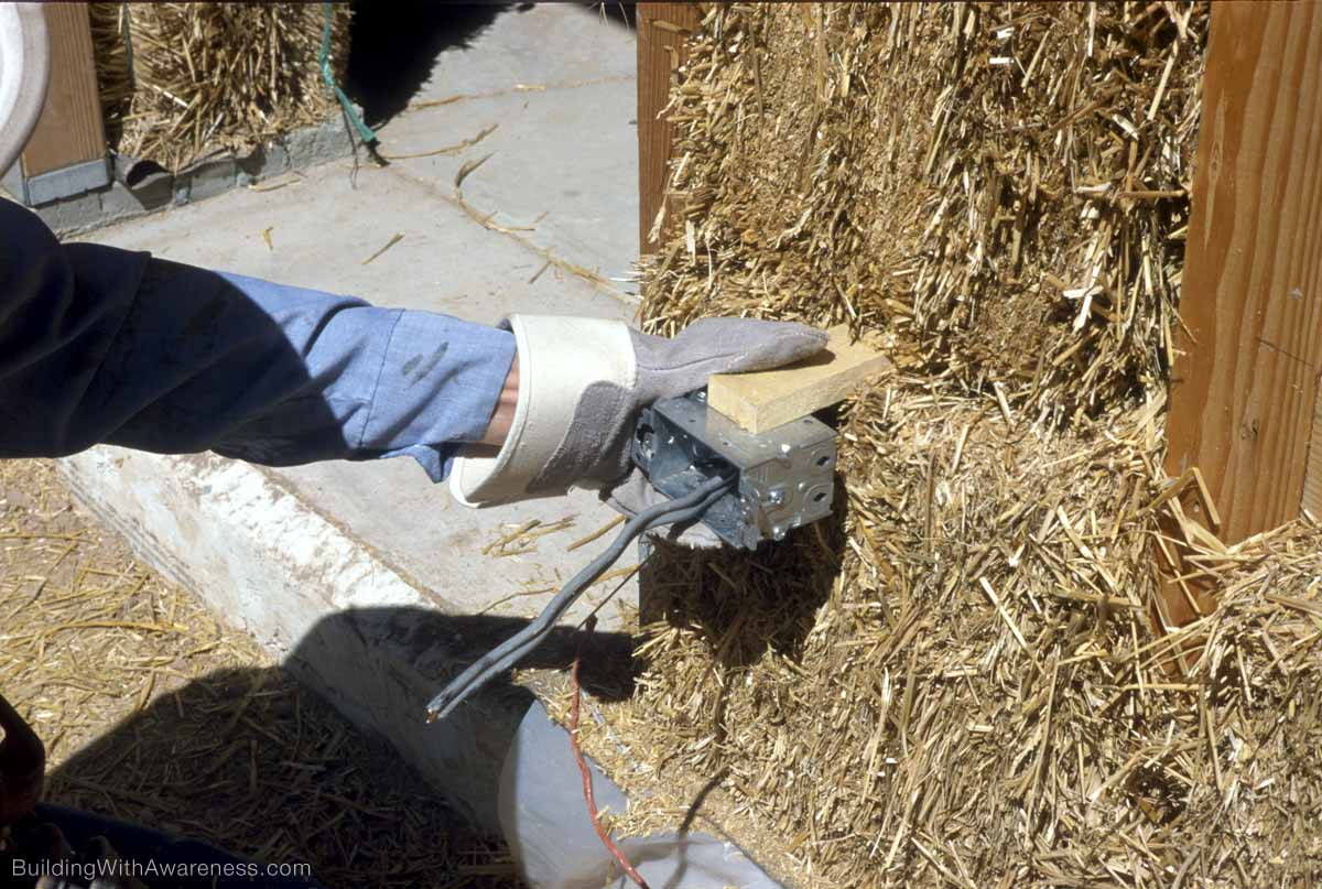 Rewiring House Lighting Cable Installing Electrical Wiring In A Straw Bale